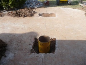 foundation hole with empty sonotube in place