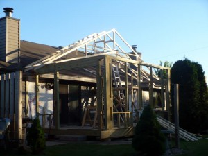 three season room trusses going up
