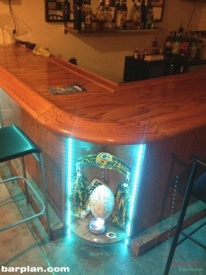 round corner bar with green bay packer memorabilia display