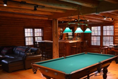 billiard table with three overhead lights