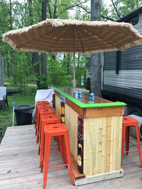 outdoor tiki bar with umbrella