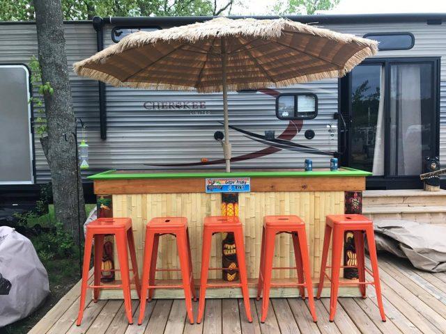 camping bar set up on deck next to camper