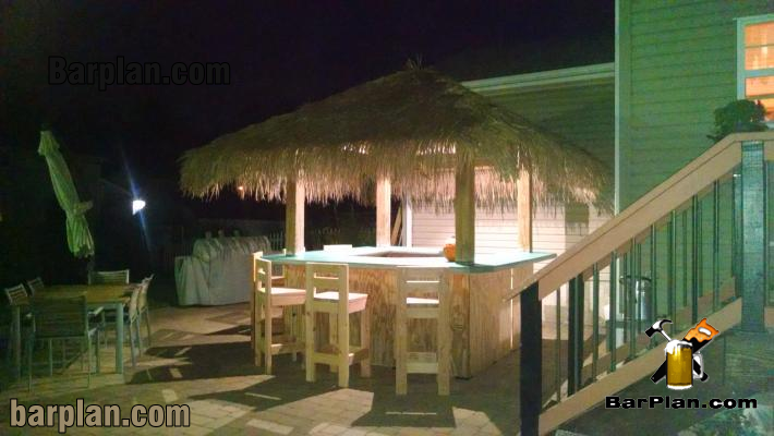 lighted tiki bar hut at night
