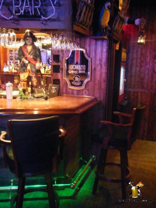 basement pirate theme bar with captain morgan statue
