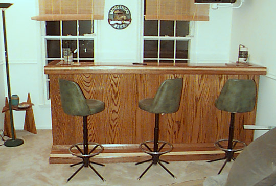 completed home bar with bar stools
