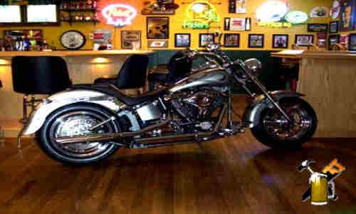 harley motorcycle parked in home bar