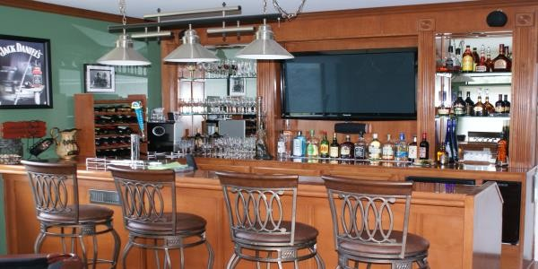 home bar with TV bar back