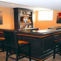 elegant orange and black home bar
