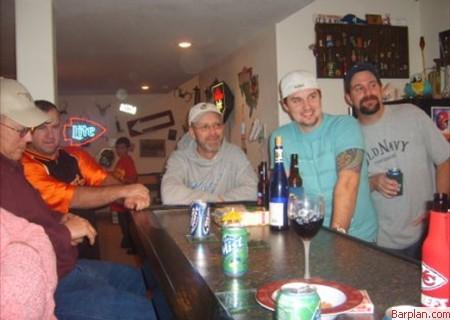 guys watching tv at home bar
