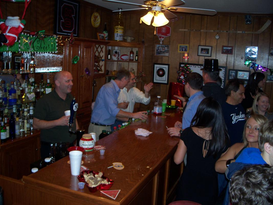 people being served at home bar