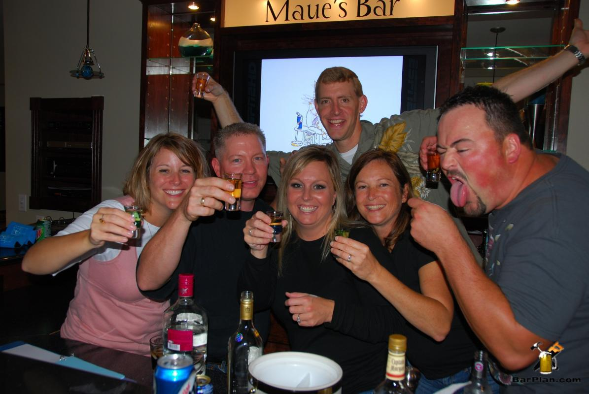 friends toasting at home bar