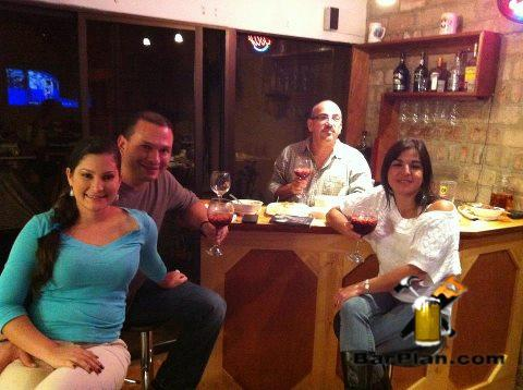 people relaxing around home bar