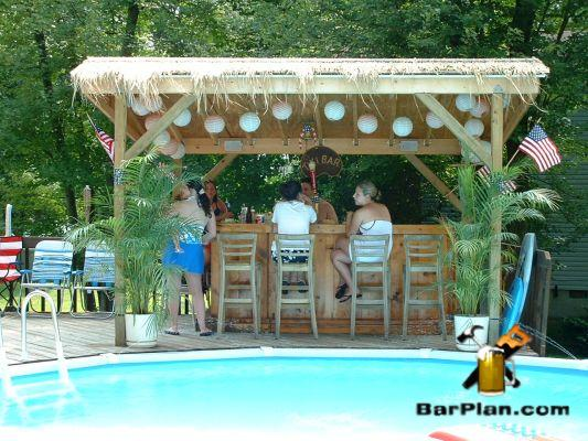peopl sitting at backyard poolside tiki bar