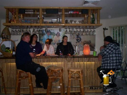 friends sitting at home bar