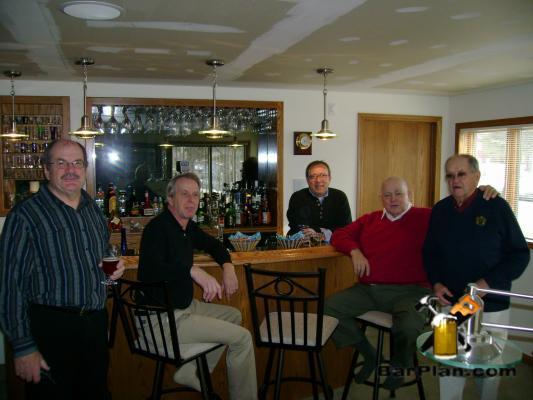 gentlemen sitting around curved home bar