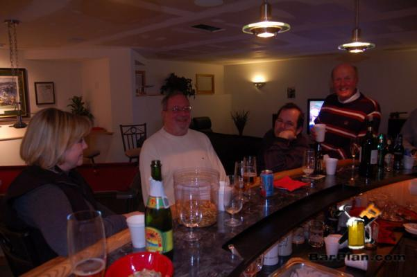 friends sitting around home bar