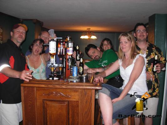 group of people sitting around home bar