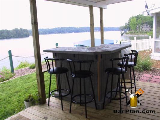 bar bult on deck overlooking lake
