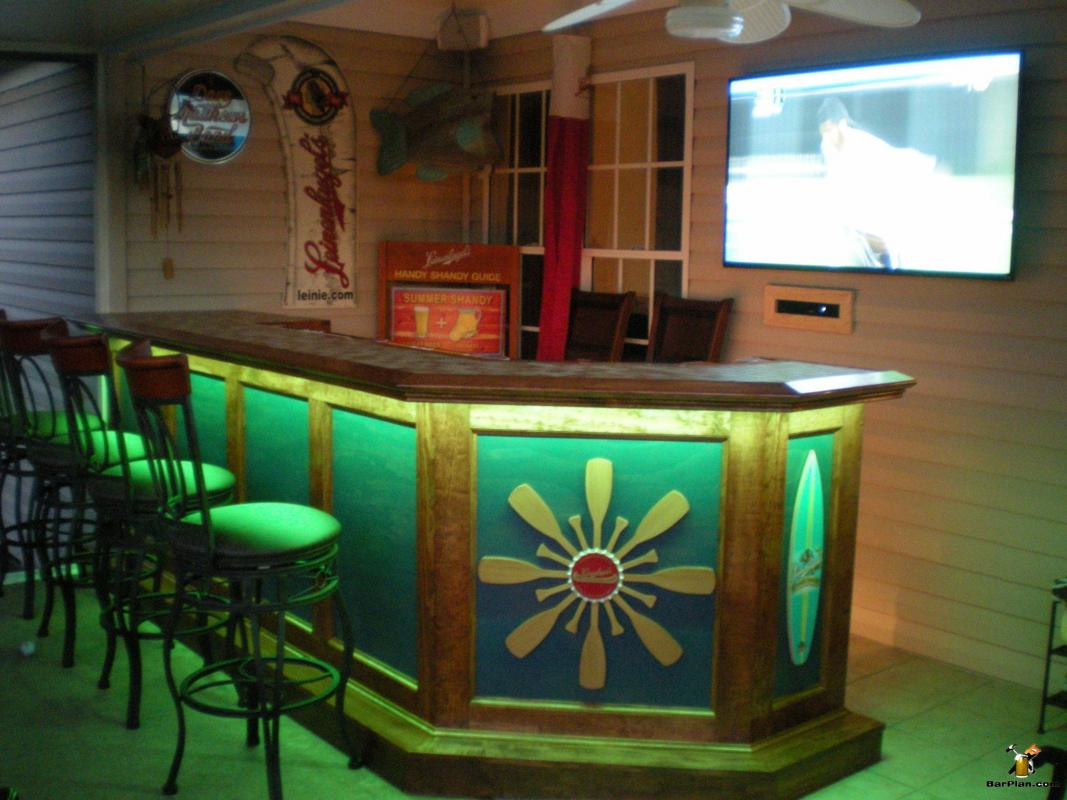 lighted patio wet bar with TV and barstools