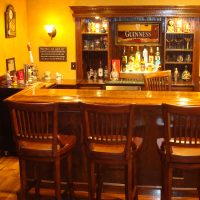 45 degree wet bar with beautifully trimmed bar back