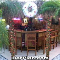 outddor tropical bar decorated for Christmas