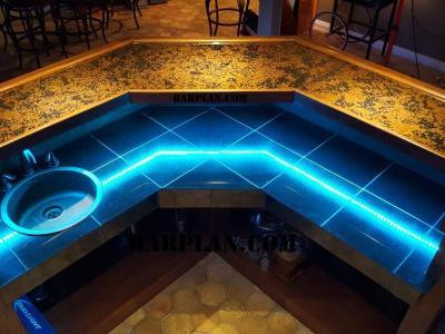 top down image of bartender side of copper top 45 corner wet bar