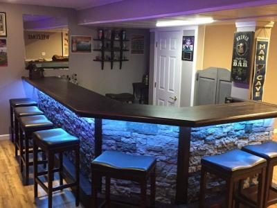stone front home bar with LED accent lighting