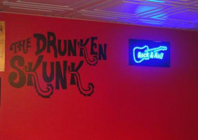 the drunken skunk speakeasy logo