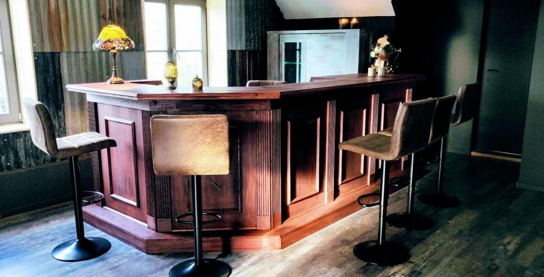steampunk themed home bar with chairs