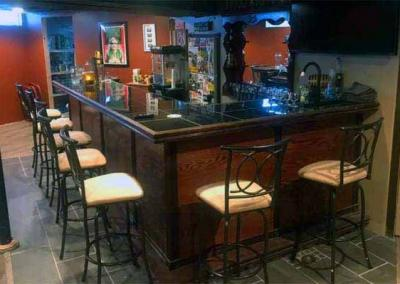 l-shaped home bar in basement