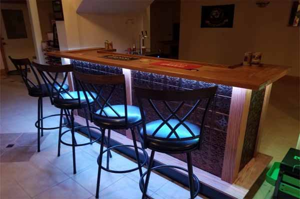 wet bar with chairs and bar lighting